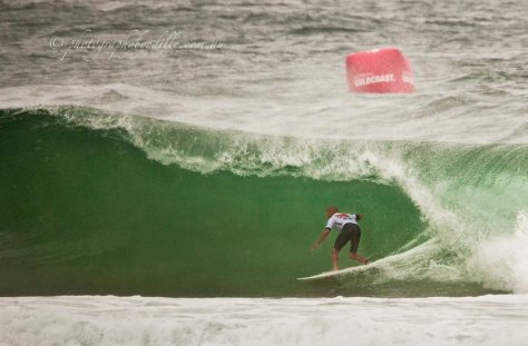 Kelly Slater as the barrel forms over him on his first wave, which earned him a 8.73 score
