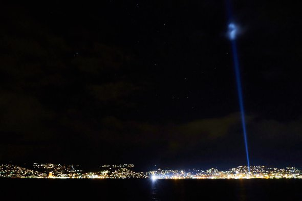 The Night Ship and the Pulse beam against a backdrop of Hobart's waterfront